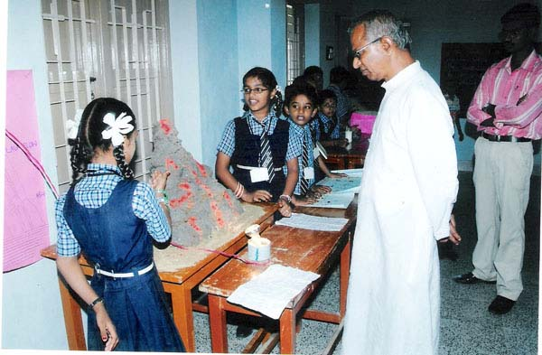 A Student describing her Project to Rev.Fr.Savarimuthu