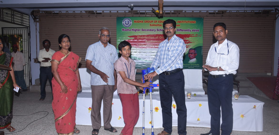 Differently Abled student is being blessed with orthopedic appliance by the Correspondent
